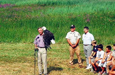 Former Secretary of the Interior, Bruce Babbitt with Liberty at the Montezuma NWR for a press conference, 1995